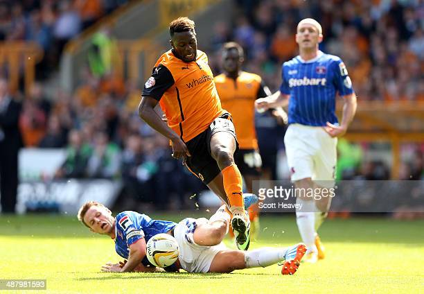 James Berrett of Carlisle slides in on Bakary Sako of Wolves during the Sky Bet League One match between Wolverhampton Wanderers and Carlisle United...