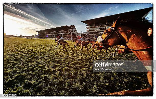 James Best riding So Fine win The Citipost Handicap Hurdle Race as the sun begins to set at Cheltenham racecourse on December 11 2015 in Cheltenham...