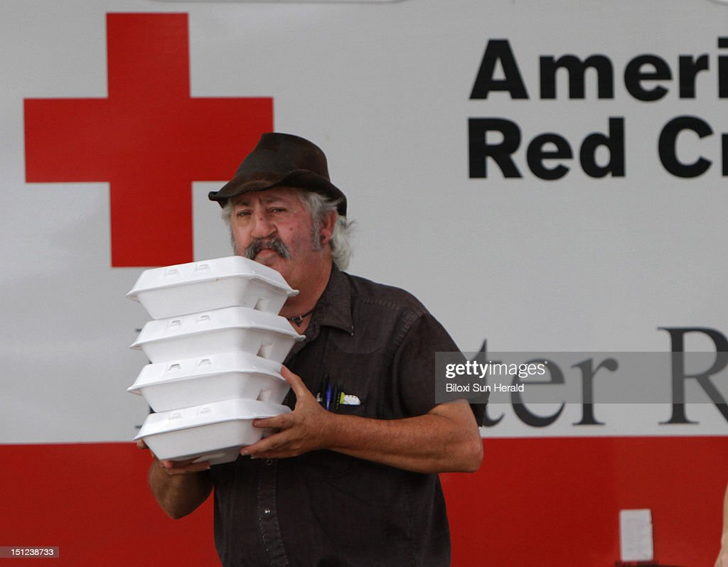 James Bishop of Lucedale, Mississippi, carries hot lunches from an American Red Cross mobile feeding unit at First Baptist Church of Helena on Tuesday, September 4, 2012 after Hurricane Isaac caused flooding in the area.