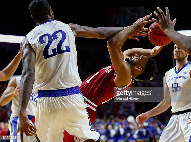 James Blackmon Jr #1 of the Indiana Hoosiers has his shot blocked by Xzavier Taylor of the Fort Wayne Mastodons in the closing moments of the game at...