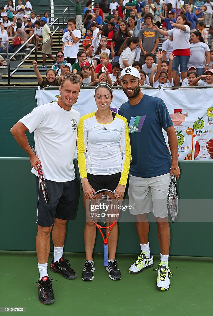 James Blake, Christine McHale, and Lleyton Hewitt of Australia participate in Lindt Kids' Day during Day 2 of the Sony Open at Crandon Park Tennis Center on March 19, 2013 in Key Biscayne, Florida.