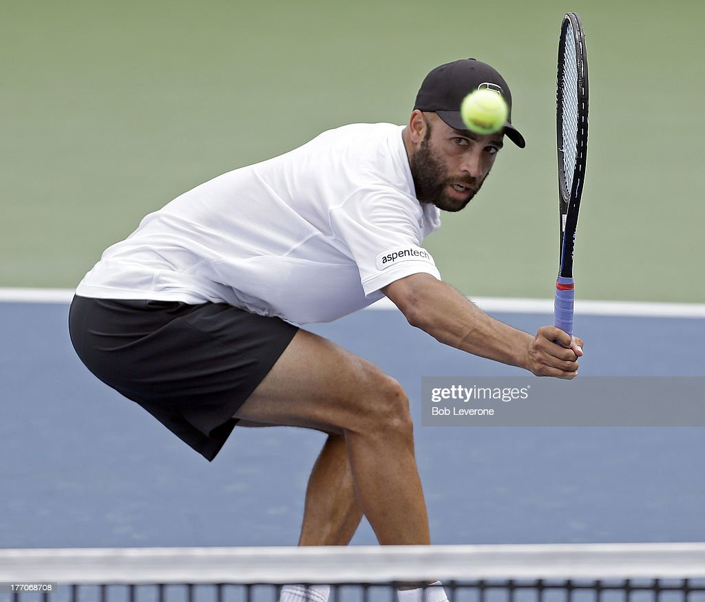 James Blake hits a soft return at the net against Benoit Paire of France on August 20, 2013 in Winston Salem, North Carolina.