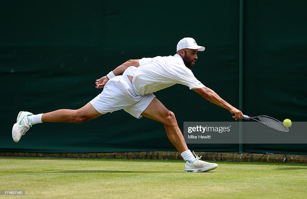 James Blake of the United States of America plays a backhand during his Gentlemen's Singles second round match against Bernard Tomic of Australia on day four of the Wimbledon Lawn Tennis Championships at the All England Lawn Tennis and Croquet Club on June 27, 2013 in London, England.