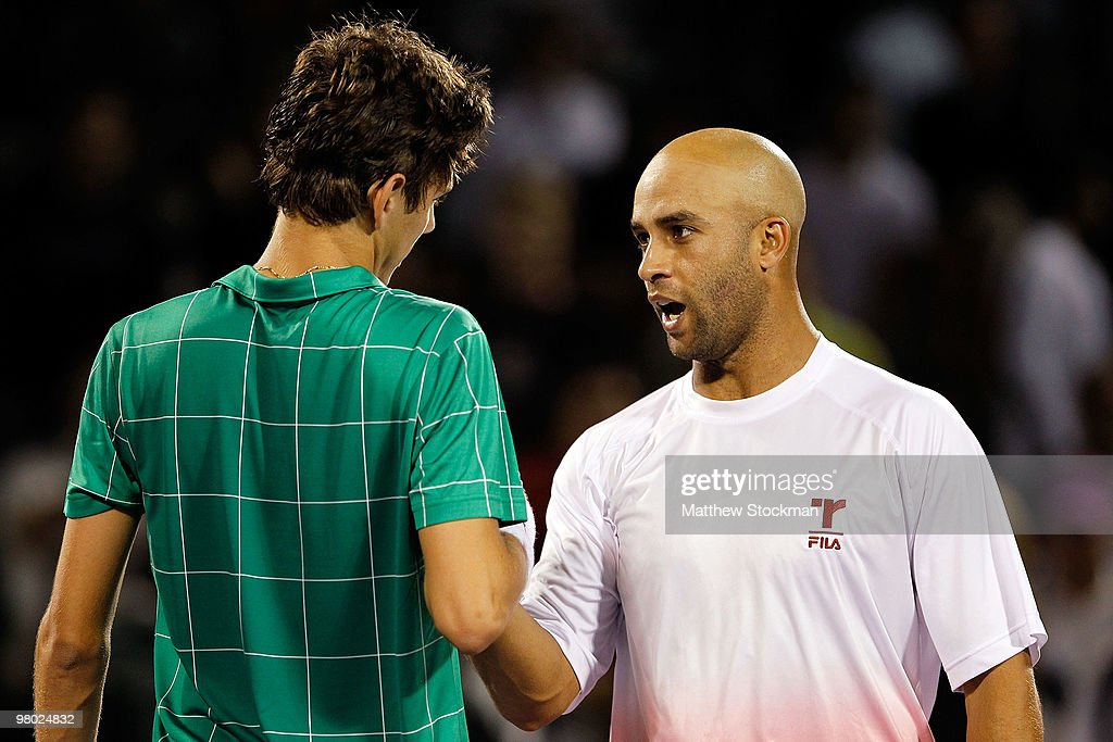 James Blake (R) of the United States shakes hands with Filip Krajinovic of Serbia after defeating him in three sets during day two of the 2010 Sony Ericsson Open at Crandon Park Tennis Center on March 24, 2010 in Key Biscayne, Florida.