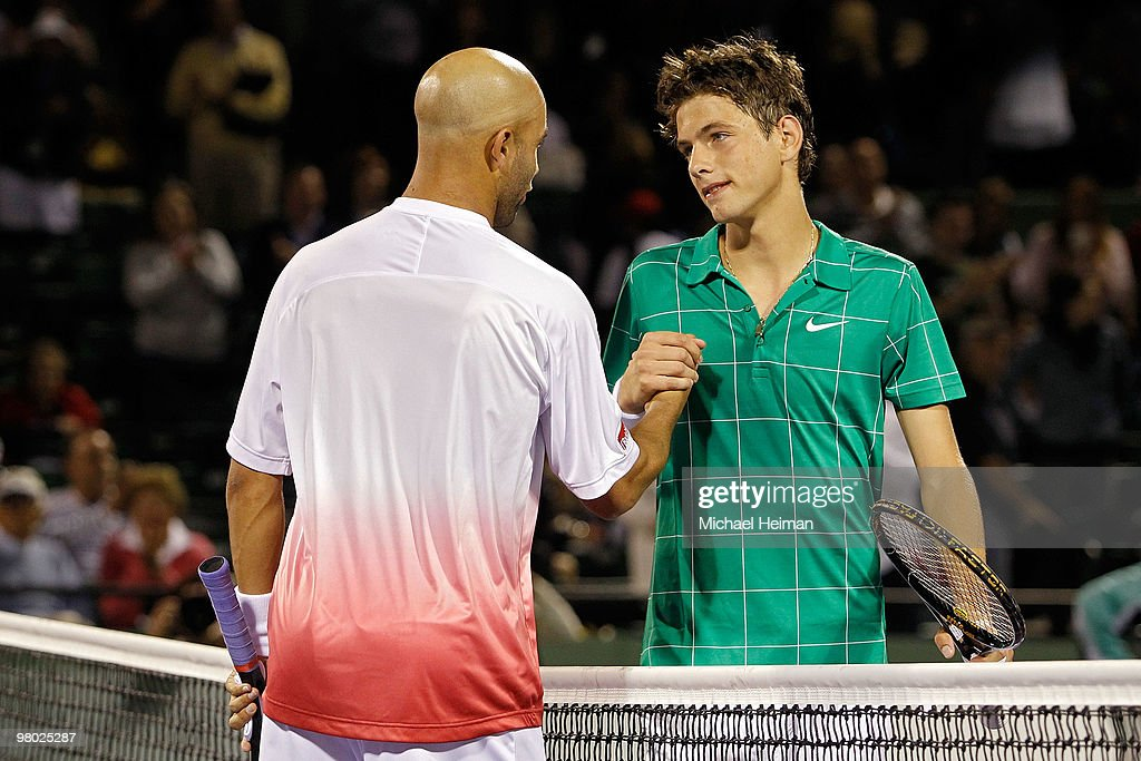 James Blake (L) of the United States shakes hands with Filip Krajinovic of Serbia after defeating him in three sets during day two of the 2010 Sony Ericsson Open at Crandon Park Tennis Center on March 24, 2010 in Key Biscayne, Florida.