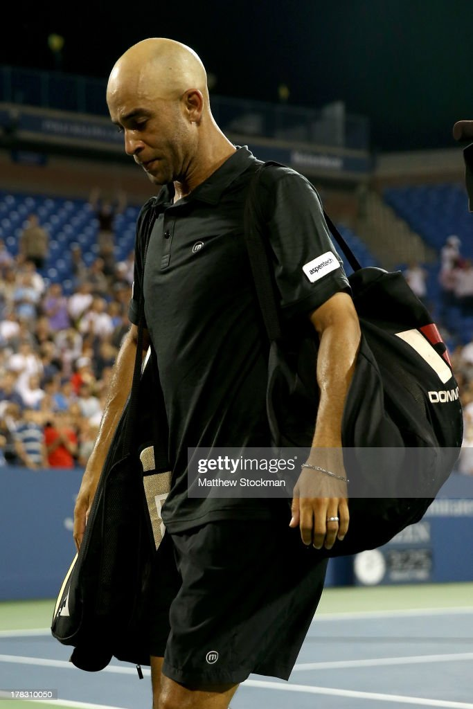 James Blake of the United States walks off court following his defeat to Ivo Karlovic of Croatia in their men's singles first round match on Day Three of the 2013 US Open at USTA Billie Jean King National Tennis Center on August 28, 2013 in the Flushing neighborhood of the Queens borough of New York City.