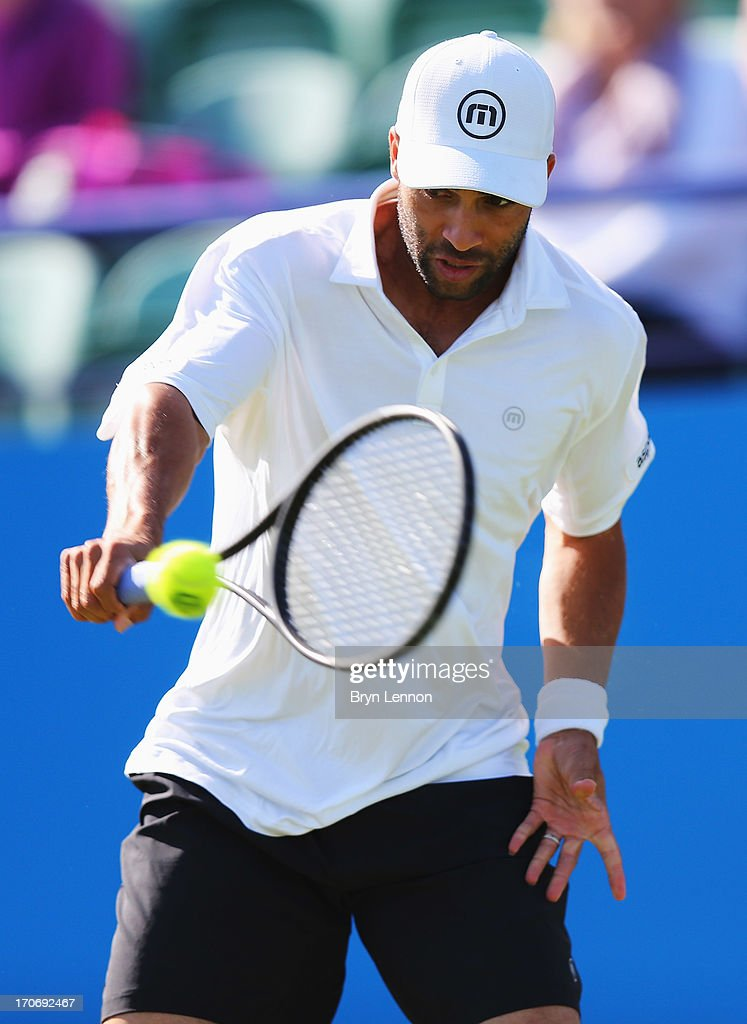 James Blake of USA returns in his men's singles qualifying match against Sergiy Stakhovsky of Ukraine during day two of the AEGON International tennis tournament at Devonshire Park on June 16, 2013 in Eastbourne, England.