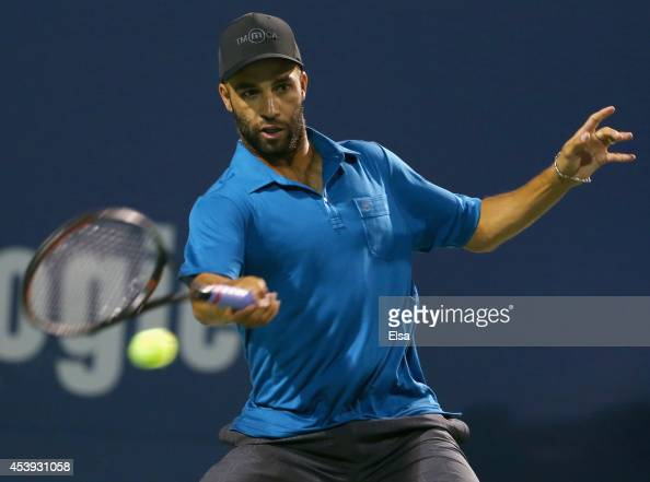 James Blake returns a shot to Andy Roddick during the Legends match during the Connecticut Open at the Connecticut Tennis Center at Yale on August 21...