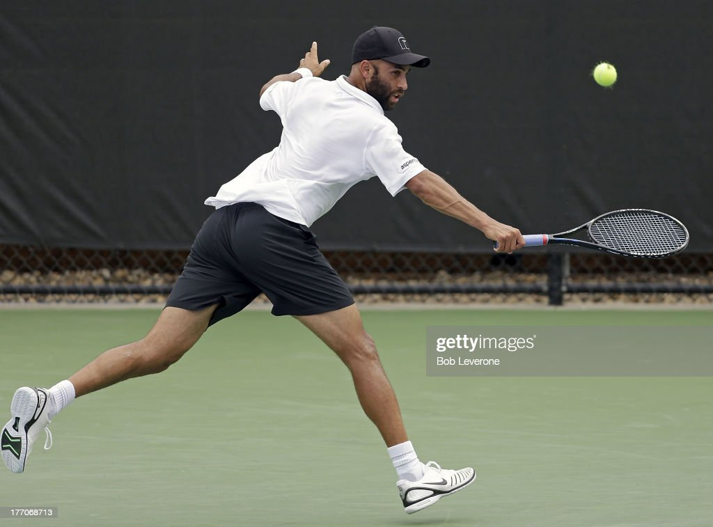 James Blake stretches to return a backhand against France's Benoit Paire on August 20, 2013 in Winston Salem, North Carolina.