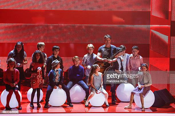 James Blunt and the Kinderchor der Komischen Oper perform during the Ein Herz Fuer Kinder Gala 2014 Show on December 6 2014 in Berlin Germany