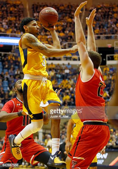 James Bolden of the West Virginia Mountaineers attempts a lay up against Thomas Brandsma of the Texas Tech Red Raiders at the WVU Coliseum on...