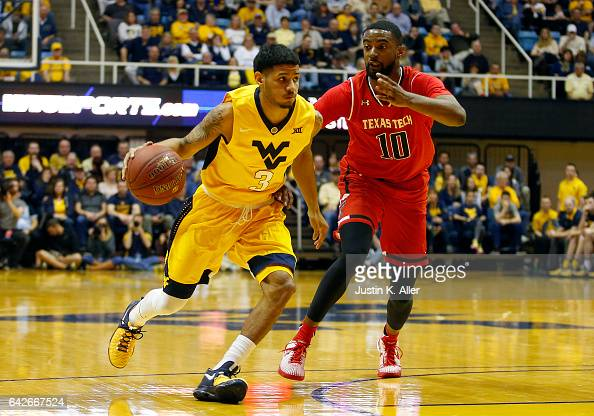 James Bolden of the West Virginia Mountaineers brings the ball up court against Niem Stevenson of the Texas Tech Red Raiders at the WVU Coliseum on...
