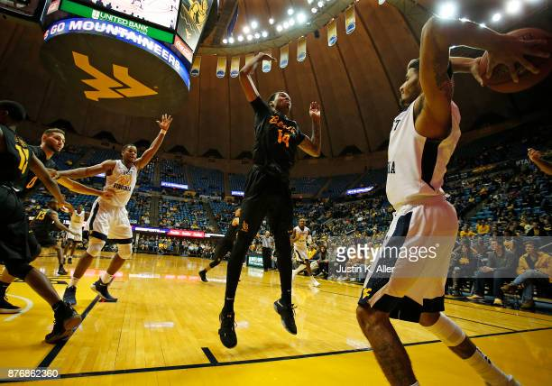 James Bolden of the West Virginia Mountaineers inbounds against KJ Byers of the Long Beach State 49ers at the WVU Coliseum on November 20 2017 in...