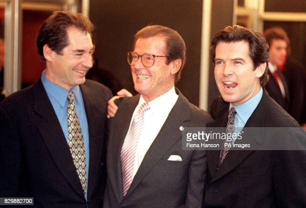 James Bond actors Timothy Dalton Roger Moore and Pierce Brosnan arrive for today's memorial service for film producer Albert 'Cubby' Broccoli at the...