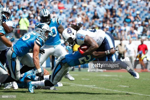 James Bradberry of the Carolina Panthers tackles Derrick Henry of the Tennessee Titans behind the line of scrimmage in the first quarter of a...