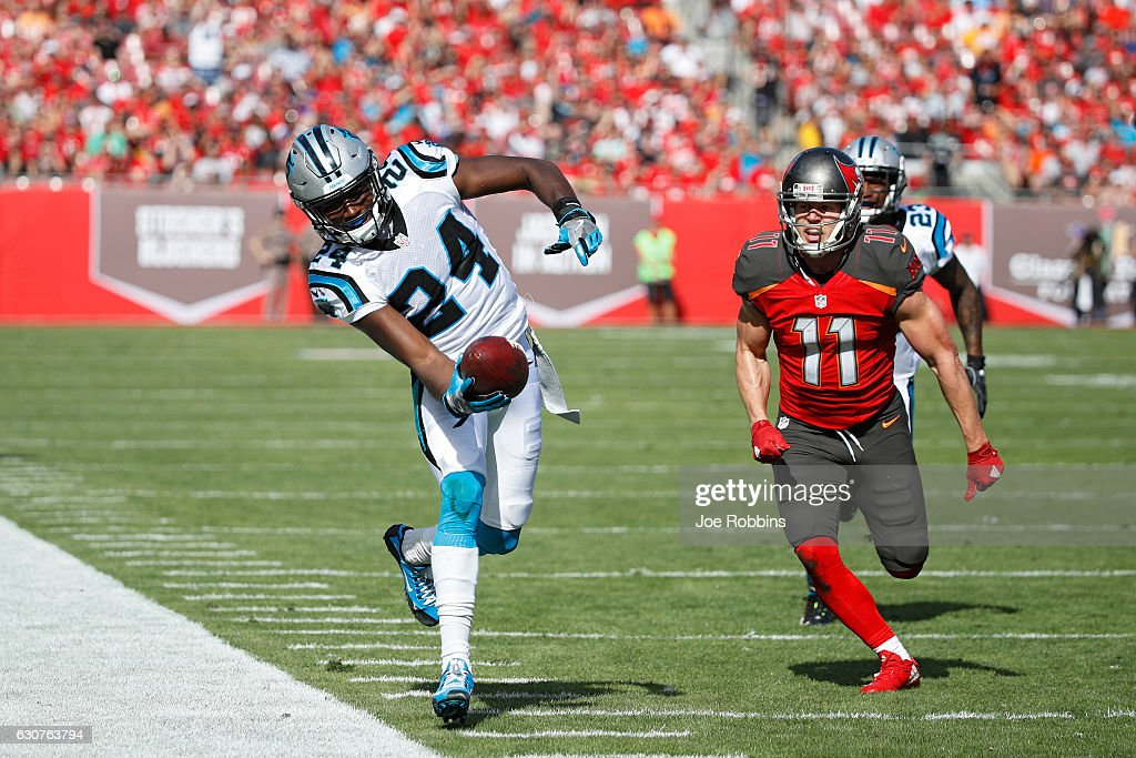 James Bradberry #24 of the Carolina Panthers tries to stay inbounds after an interception against the Tampa Bay Buccaneers in the first quarter of the game at Raymond James Stadium on January 1, 2017 in Tampa, Florida.