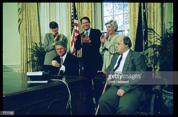 James Brady Sarah Brady Al Gore Janet Reno and Bill Clinton celebrate the Senate's passing of the Brady Bill November 24 1983 at the White House The...