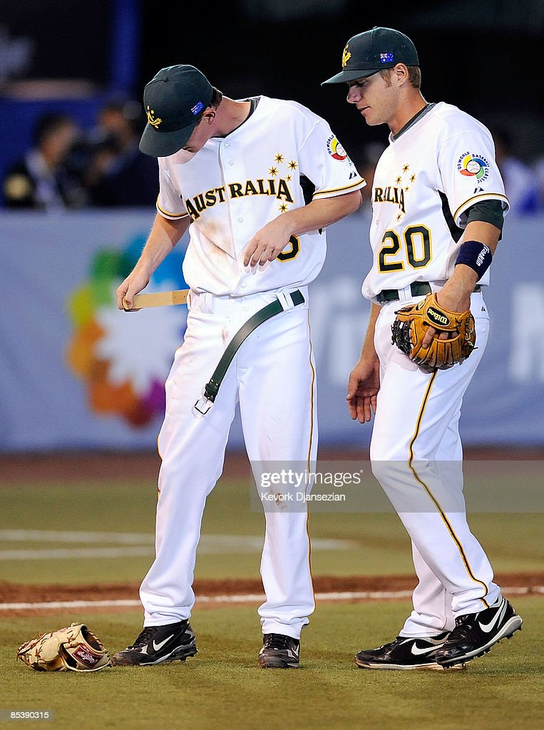 James Breseford of Australia replaces his belt after breaking it during a groundout by Mexico during the 2009 World Baseball Classic Pool B match on...