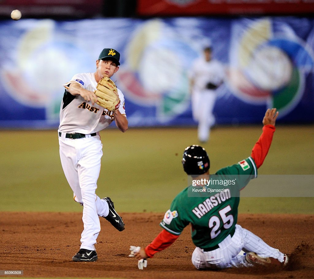 James Breseford of Australia turns a double play as he forces Jerry Hairston Jr #25 of Mexico at second base during the 2009 World Baseball Classic...