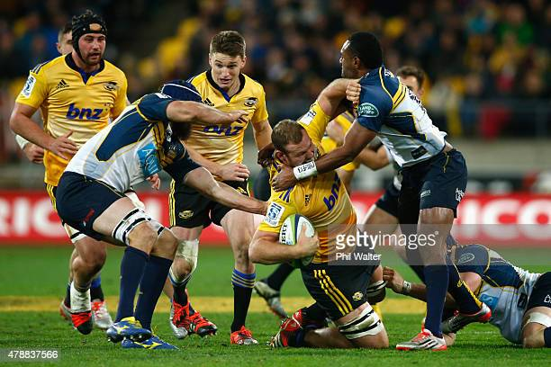 James Broadhurst of the Hurricanes is tackled during the Super Rugby Semi Final match between the Hurricanes and the Brumbies at Westpac Stadium on...
