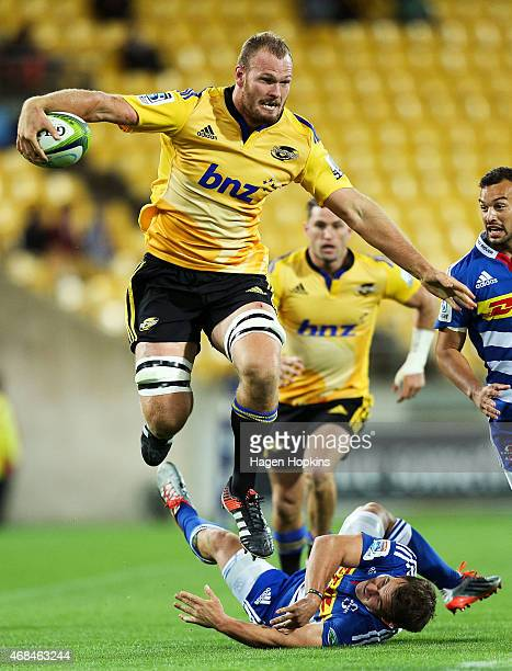 James Broadhurst of the Hurricanes runs over the tackle of Nic Groom of the Stormers makes a break during the round eight Super Rugby match between...