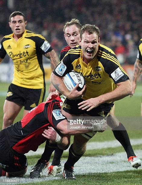 James Broadhurst of the Hurricanes with the ball in the tackle of Kieran Read of the Crusaders during the round 20 Super Rugby match between the...