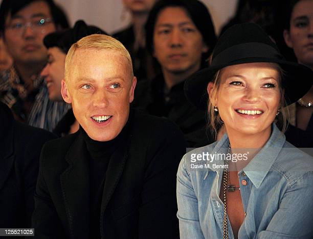 James Brown and Kate Moss sit in the front row at the Mulberry Spring/Summer 2012 runway show during London Fashion Week at Claridges Hotel on...