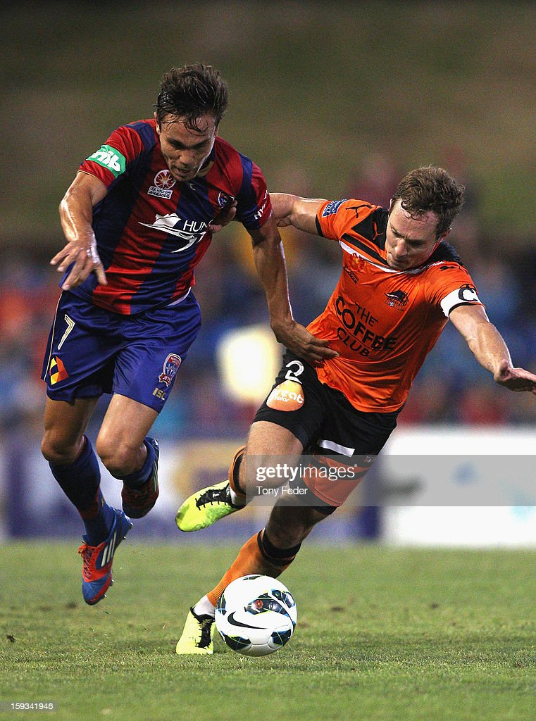 James Brown of the Jets and Matthew Smith of the Roar contest the ball during the round 16 A-League match between the Newcastle Jets and the Brisbane Roar at Hunter Stadium on January 12, 2013 in Newcastle, Australia.