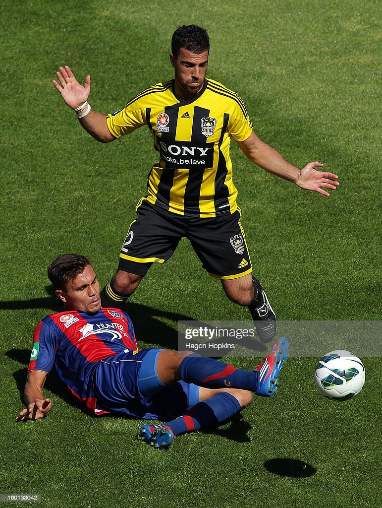 James Brown of the Jets plays the ball on the ground after colliding with Manny Muscat of the Phoenix during the round 18 A-League match between the Wellington Phoenix and the Newcastle Jets at Westpac Stadium on January 27, 2013 in Wellington, New Zealand.