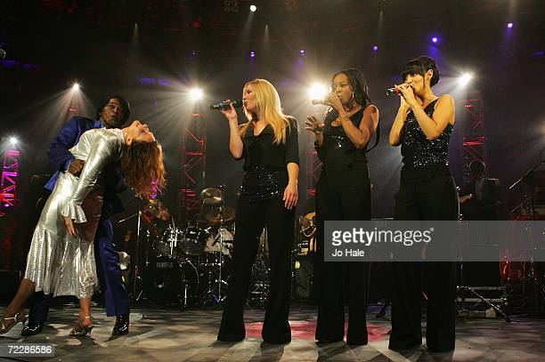 James Brown performs with Heidi Range Keisha Buchanan and Amelie Berrabah of the Sugababes at the Roundhouse as part of the BBC Electric Proms on...