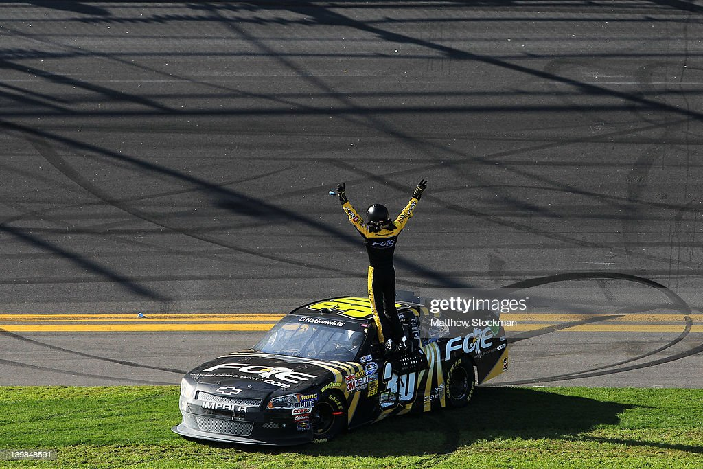 James Buescher, driver of the #30 Fraternal Order of Eagles Chevrolet, celebrates on top of his car after winning the NASCAR Nationwide Series DRIVE4COPD 300 at Daytona International Speedway on February 25, 2012 in Daytona Beach, Florida.