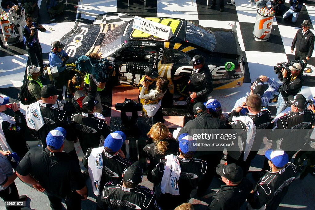 <a gi-track='captionPersonalityLinkClicked' href=/galleries/search?phrase=James+Buescher&family=editorial&specificpeople=5409134 ng-click='$event.stopPropagation()'>James Buescher</a>, driver of the #30 Fraternal Order of Eagles Chevrolet, kisses wife Kris in Victory Lane after winning the NASCAR Nationwide Series DRIVE4COPD 300 at Daytona International Speedway on February 25, 2012 in Daytona Beach, Florida.