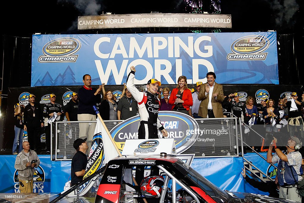 <a gi-track='captionPersonalityLinkClicked' href=/galleries/search?phrase=James+Buescher&family=editorial&specificpeople=5409134 ng-click='$event.stopPropagation()'>James Buescher</a>, driver of the #31 Great Clips Chevrolet, celebrates in Champions Victory Lane after winning the Series Championship and finishing in thirteenth place in the NASCAR Camping World Truck Series Ford EcoBoost 200 at Homestead-Miami Speedway on November 16, 2012 in Homestead, Florida.