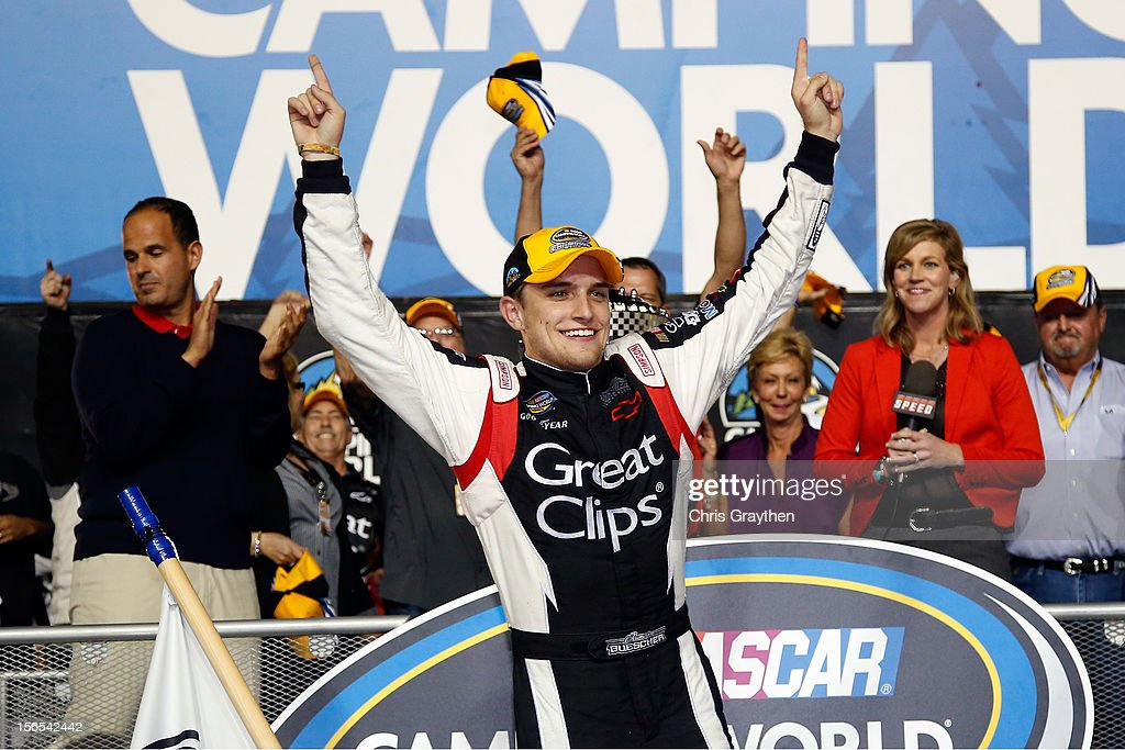 James Buescher, driver of the #31 Great Clips Chevrolet, celebrates in Champions Victory Lane after winning the Series Championship and finishing in thirteenth place in the NASCAR Camping World Truck Series Ford EcoBoost 200 at Homestead-Miami Speedway on November 16, 2012 in Homestead, Florida.