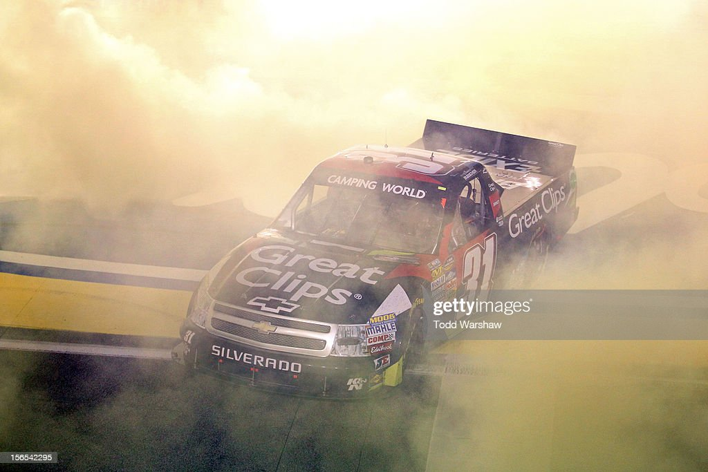<a gi-track='captionPersonalityLinkClicked' href=/galleries/search?phrase=James+Buescher&family=editorial&specificpeople=5409134 ng-click='$event.stopPropagation()'>James Buescher</a>, driver of the #31 Great Clips Chevrolet, celebrates with a burnout after winning the Series Championship and finishing in thirteenth place in the NASCAR Camping World Truck Series Ford EcoBoost 200 at Homestead-Miami Speedway on November 16, 2012 in Homestead, Florida.