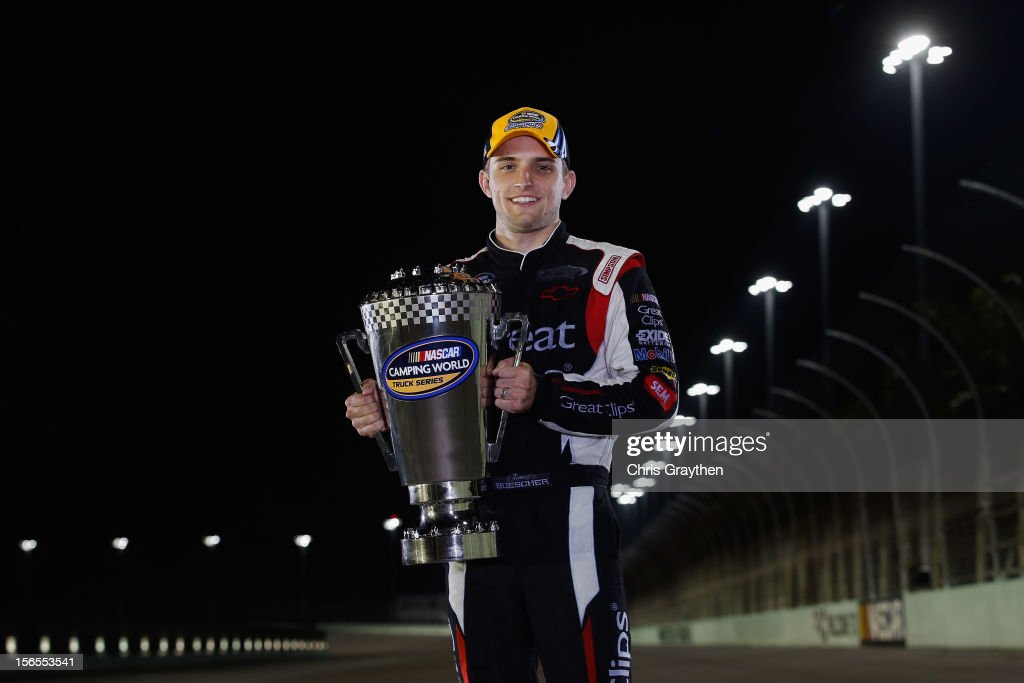 <a gi-track='captionPersonalityLinkClicked' href=/galleries/search?phrase=James+Buescher&family=editorial&specificpeople=5409134 ng-click='$event.stopPropagation()'>James Buescher</a>, driver of the #31 Great Clips Chevrolet, poses after winning the NASCAR Camping World Truck Series Championship after the Ford EcoBoost 200 at Homestead-Miami Speedway on November 16, 2012 in Homestead, Florida.