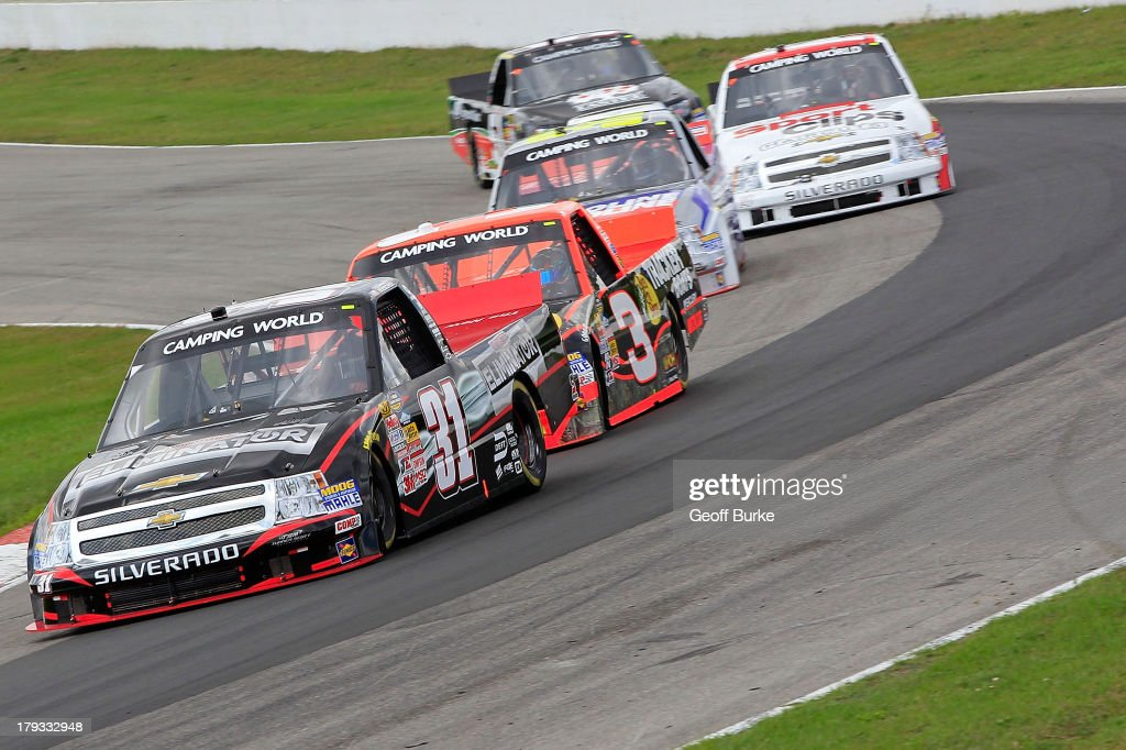 <a gi-track='captionPersonalityLinkClicked' href=/galleries/search?phrase=James+Buescher&family=editorial&specificpeople=5409134 ng-click='$event.stopPropagation()'>James Buescher</a>, driver of the #31 Motomaster Elimonator Chevrolet, and <a gi-track='captionPersonalityLinkClicked' href=/galleries/search?phrase=Ty+Dillon&family=editorial&specificpeople=6312493 ng-click='$event.stopPropagation()'>Ty Dillon</a>, driver of the #3 Bass Pro Shops/Tracker Boats Chevrolet, lead a group of trucks during the NASCAR Camping World Truck Series Chevrolet Silverado 250 at Canadian Tire Motorsport Park on September 1, 2013 in Bowmanville, Canada.