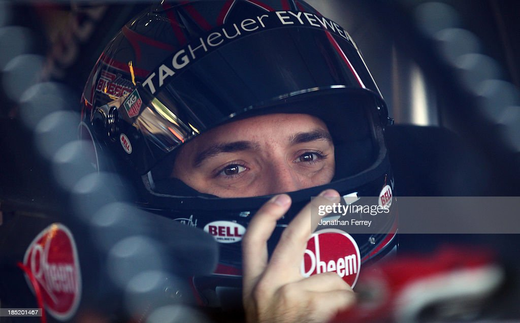 James Buescher, driver of the #31 Rheem Chevrolet, looks on from his truck during practice for the Camping World Truck Series Fred's 250 at Talladega Superspeedway on October 18, 2013 in Talladega, Alabama.