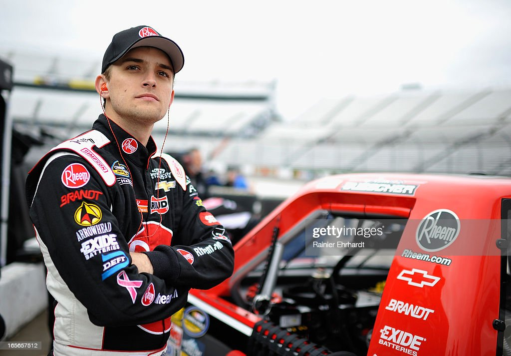 James Buescher, driver of the #31 Rheem Chevrolet, stands by his truck during practice for the NASCAR Camping World Truck Series Kroger 250 on April 5, 2013 at Martinsville Speedway in Ridgeway, Virginia.