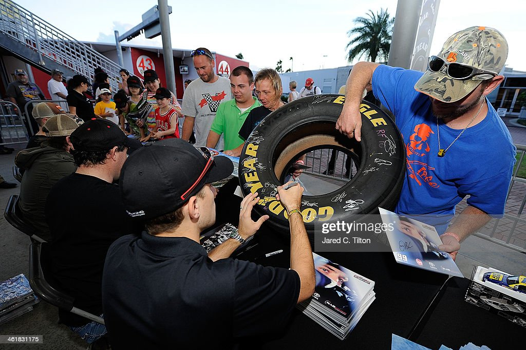 James Buescher, driver of the #99 Rheem Toyota, signs autographs along with other Nationwide Series drivers during NASCAR Preseason Thunder at Daytona International Speedway on January 11, 2014 in Daytona Beach, Florida.