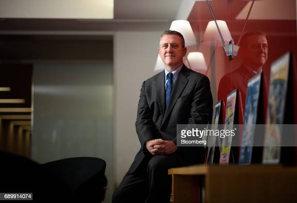 James Bullard president and chief executive officer at the Federal Reserve Bank of St Louis poses for a photograph in Tokyo Japan on Tuesday May 30...