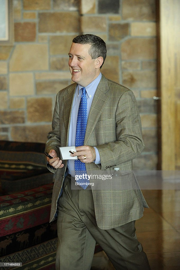 James Bullard, president of the Federal Reserve Bank of St. Louis, arrives at the Jackson Hole economic symposium, sponsored by the Kansas City Federal Reserve Bank at the Jackson Lake Lodge in Moran, Wyoming, U.S., on Friday, Aug. 23, 2013. The U.S. central banks bond buying is a less potent tool for stimulating growth than policy makers believe, two economists said in a paper released today at a Federal Reserve conference. Photographer: Price Chambers/Bloomberg via Getty Images