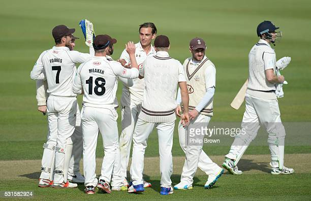 James Burke of Surrey celebrates after dismissing Adam Voges of Middlesex during day one of the Specsavers County Championship Division One match...