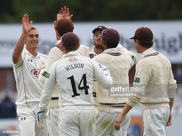 James Burke of Surrey celebrates the wicket of Thomas Poynton of Derbyshire during the LV County Championship match between Derbyshire and Surrey at...