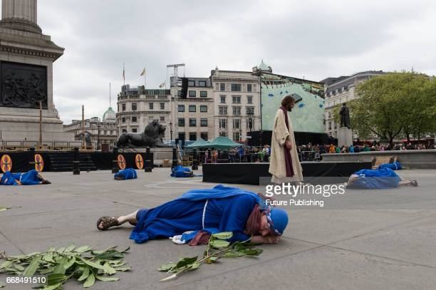 James BurkeDunsmore seen as Jesus walking among his sleeping disciples in the Garden of Gethsemane during the annual play of The Passion of Jesus by...
