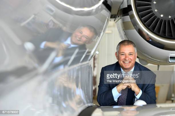 James Butler with Shaircraftcom poses by a Hawker 800XP aircraft similar to one used in the fleet April 20 2017 in Leesburg VA The business like Uber...