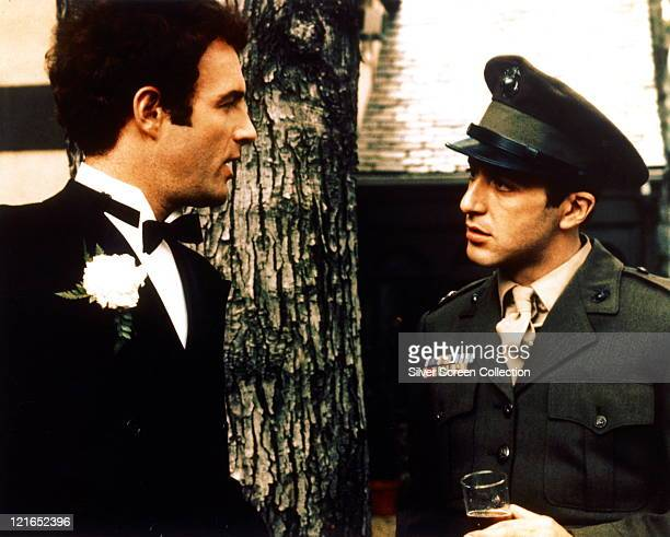 James Caan US actor wearing a dinner suit with a white shirt with wingtip collars and a black bow tie and Al Pacino US actor in military uniform in a...