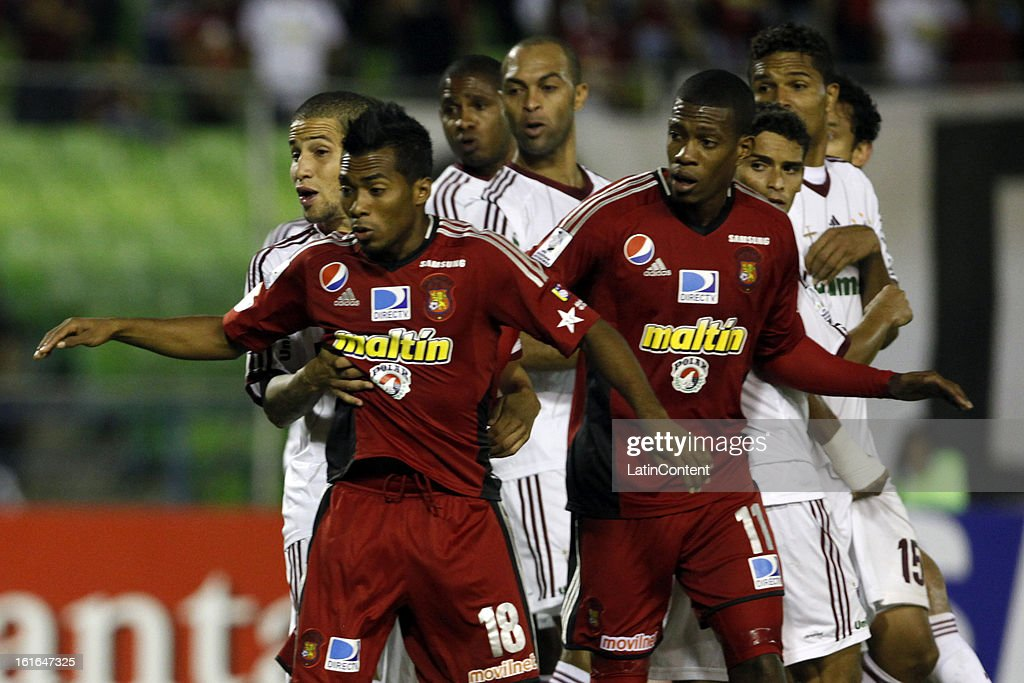 James Cabezas and Luis Gonzalez of Caracas FC during a match between Caracas FC and Fluminense as part of the 2013 Copa Bridgestone Libertadores at the Olympic Stadium on February 13, 2013 in Caracas, Venezuela.