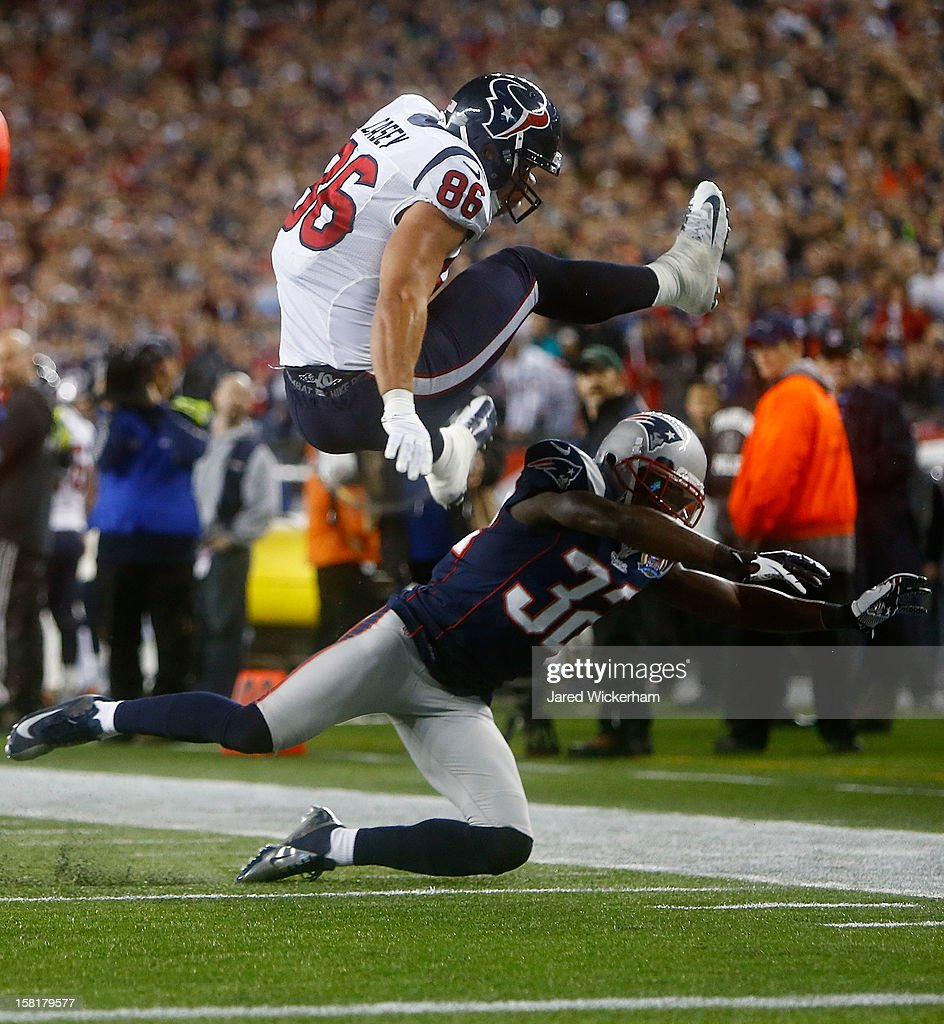 James Casey #86 of the Houston Texans attempts to hurdle <a gi-track='captionPersonalityLinkClicked' href=/galleries/search?phrase=Devin+McCourty&family=editorial&specificpeople=4510365 ng-click='$event.stopPropagation()'>Devin McCourty</a> #32 of the New England Patriots after catching a pass during the game at Gillette Stadium on December 10, 2012 in Foxboro, Massachusetts.
