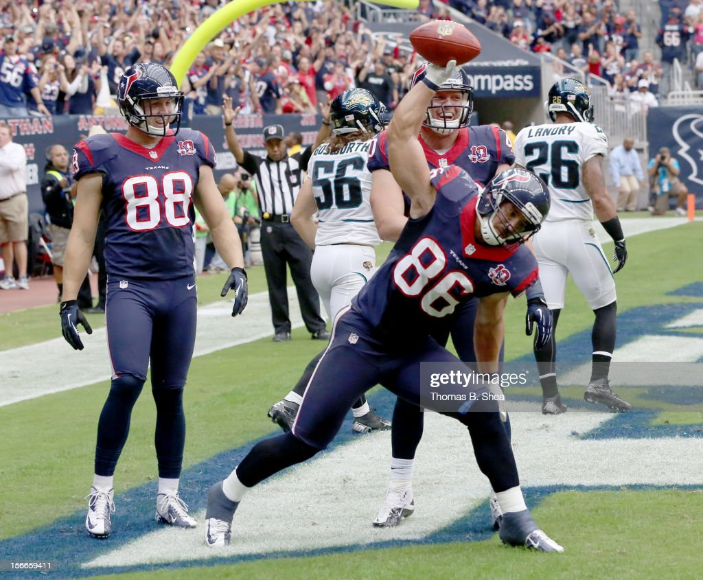 James Casey #86 of the Houston Texans spikes the ball after catching a touchdown pass against the Jacksonville Jaguars on November 18, 2012 at Reliant Stadium in Houston, Texas.